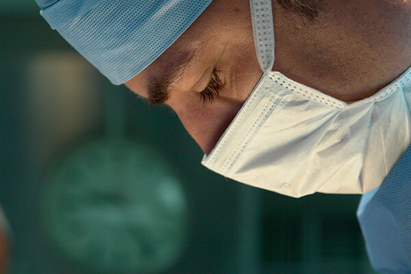 Closeup of a young male surgeon