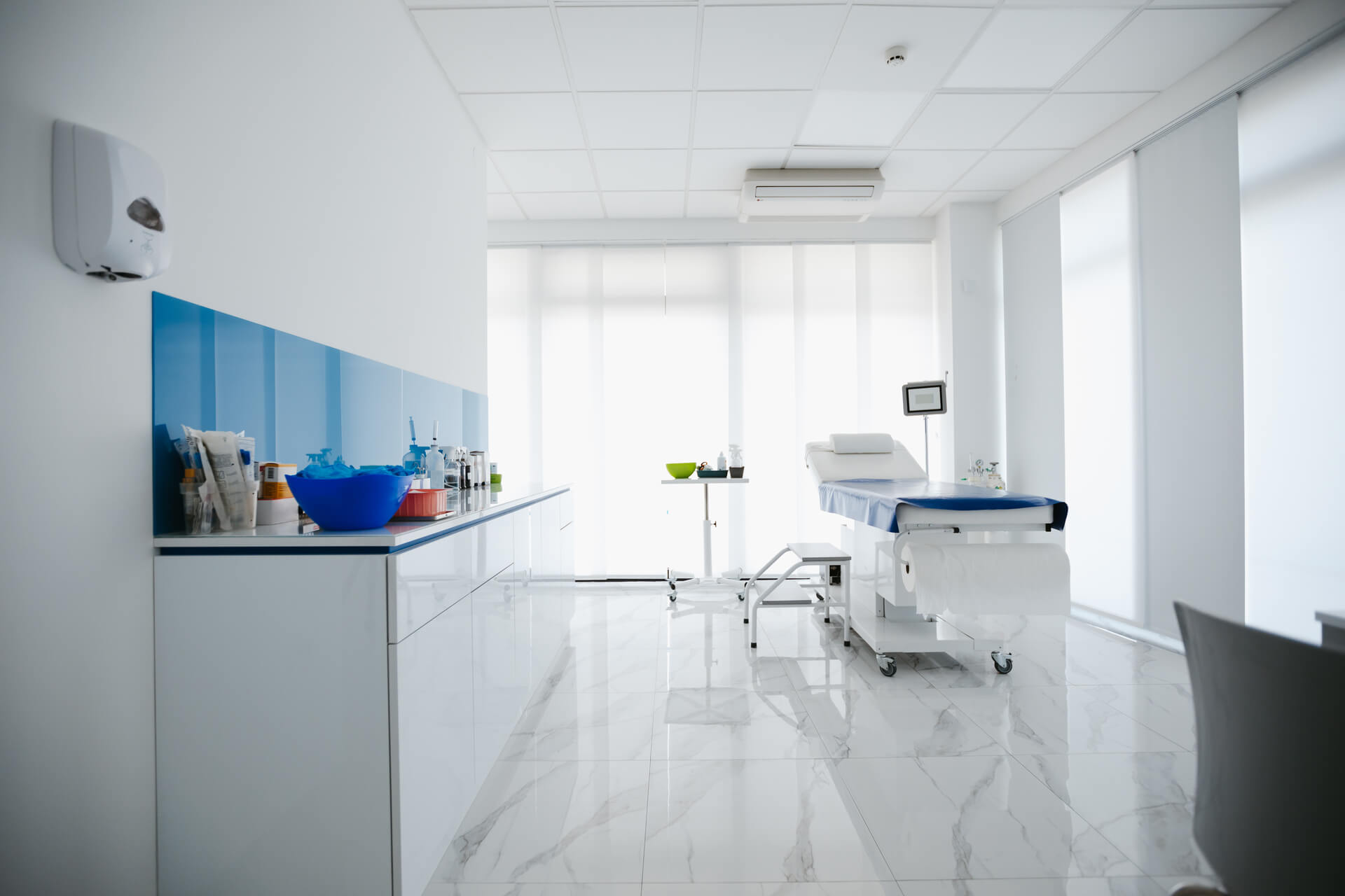 Doctor examination room with examination table.